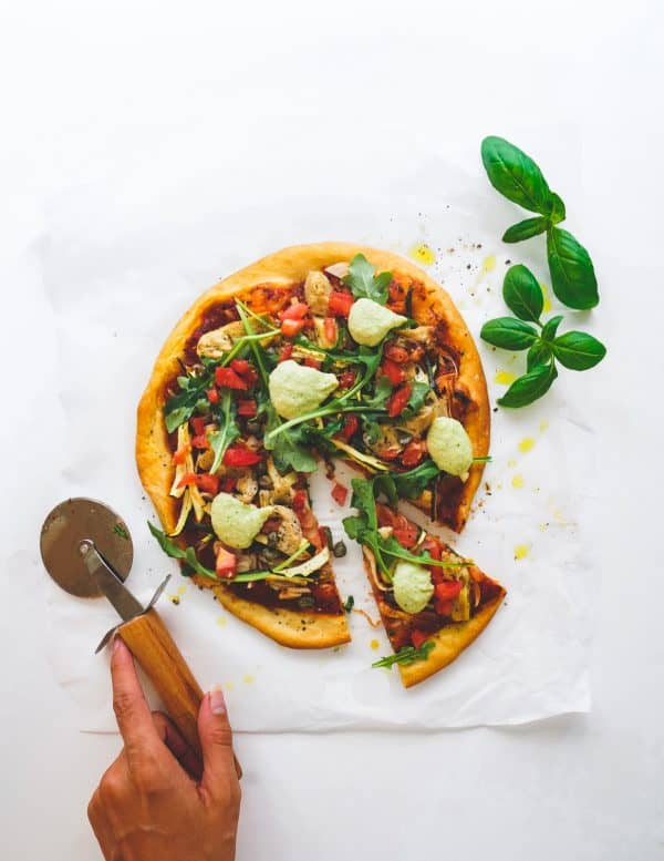 This plant-based pizza dough is infused with garlic and onions and incredibly versatile which makes it perfect for the whole family on pizza night!