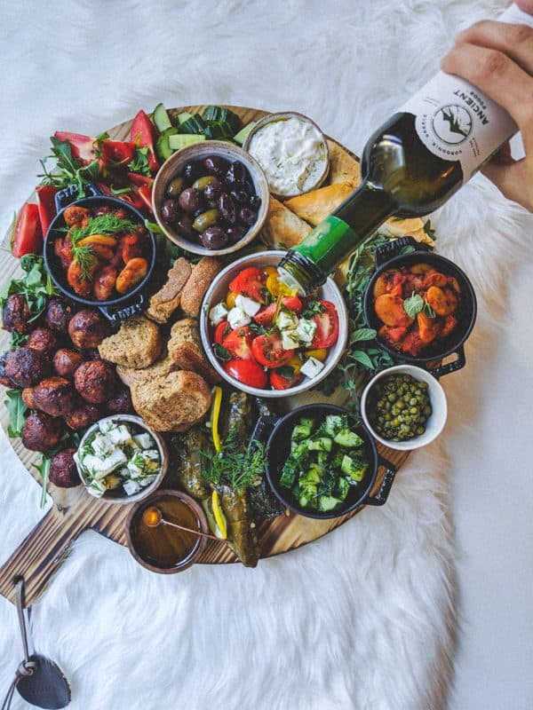 This plant based Greek platter drizzled with Ancient Foods olive oil will please all of your guests. I've included three vegan recipes in this post.